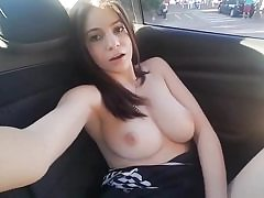 Horny babe gets big wet orgasm in her car rubbing her cunt