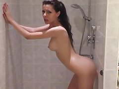 Indeed hot girl is taking douche and is nailing her twat with dildo